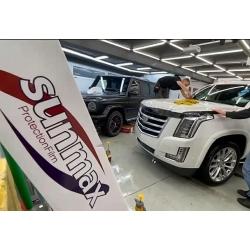 Оклейка полиуретановой пленкой sunmax Cadillac белый