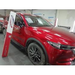 Оклейка полиуретановой пленкой sunmaxfilms красной Mazda