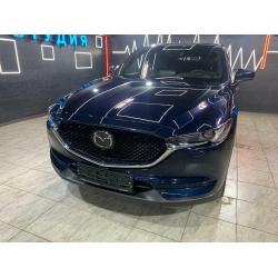 Оклейка полиуретановой пленкой Sunmaxfilms синего авто Mazda