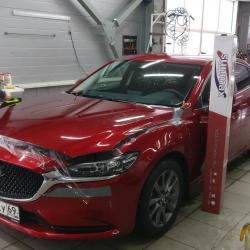 Оклейка полиуретановой пленкой Sunmaxfilms Mazda красный
