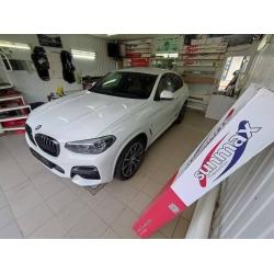 Оклейка полиуретановой пленкой Sunmaxfilms BMW белого