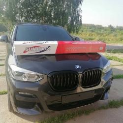 Оклейка полиуретановой пленкой Sunmaxfilms презентабельного BMW